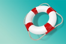 Lifebuoy On Blue Wooden Background With Place
