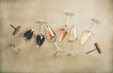 Flat-lay of red, rose and white wine in glasses and corkscrews over grey concrete background, top view, horizontal composition. Wine bar, winery, wine degustation concept - 224167347