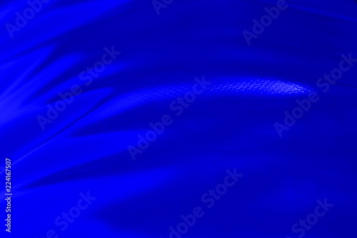 Staande foto Abstract wave texture light waves from fabric rough skin blue color