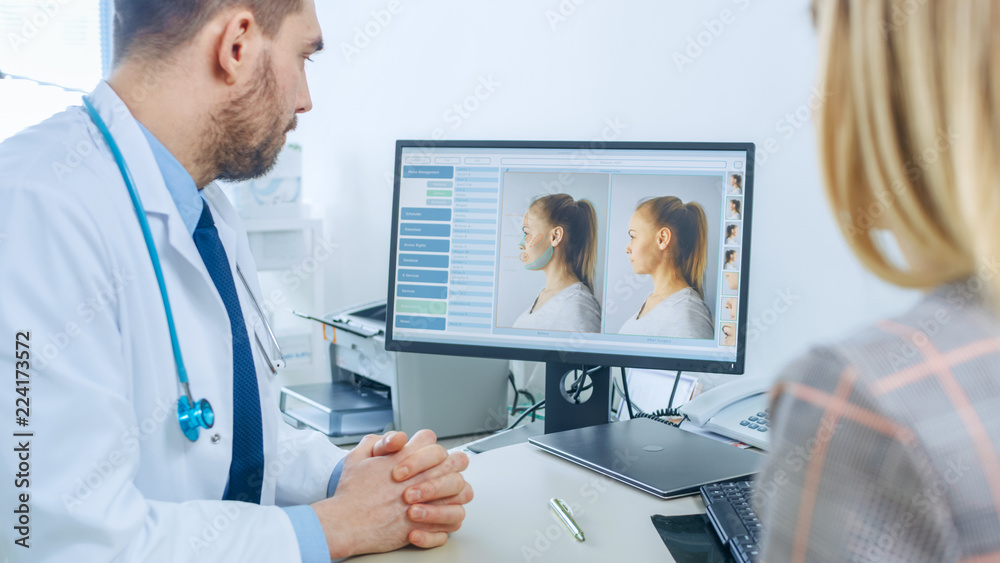 Fototapety, obrazy: Plastic / Cosmetic Surgeon Consults Woman about Facial Lift Surgery, He Points at Computer Screen Showing Types of Facelift, Forehead Lift, Cheek Bones and Nose Correcting Procedures Available.
