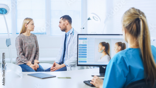 Fototapety, obrazy: Plastic / Cosmetic Surgeon Consults Woman about Facelift Surgery. Nurse Works on Computer that Shows Types of Facelift, Forehead Lift, Cheek Bones and Nose Correcting Procedures Available.