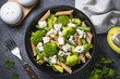 canvas print picture Whole-grain pasta penne with broccoli, avocado, green beans, pea