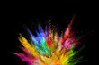 canvas print picture - Colored powder explosion on black background.