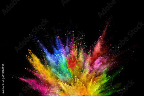 Canvas Print Colored powder explosion on black background.