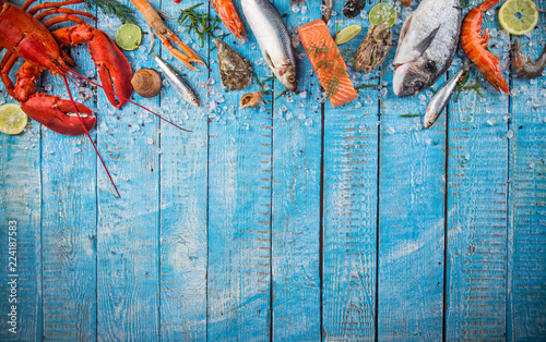Fresh tasty seafood served on old wooden table. Fototapete