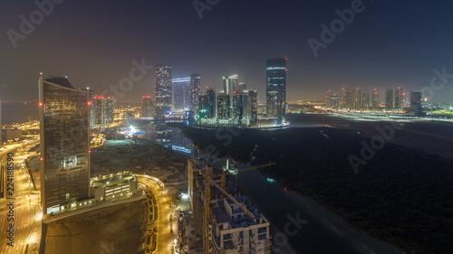 Fototapety, obrazy: Buildings on Al Reem island in Abu Dhabi night timelapse from above.