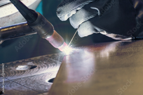 Fotografie, Obraz  Metal welding process that uses a non-consumable tungsten electrode