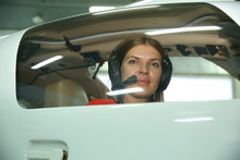 Girl Pilot In Headphones On Th...