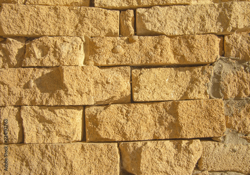 Foto op Aluminium Wand Yellow old grunge Brick Wall Vintage Stone Texture Background