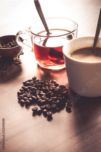 Photo Stands Coffee beans Coffee and tea with coffee bean and tea leaves on wooden floor.