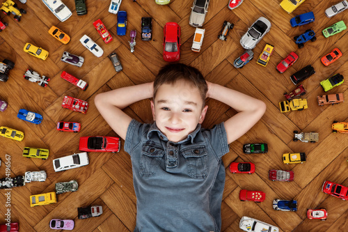 Valokuvatapetti Boy with his toy car collection
