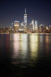 Manhattan skyline reflected in Hudson River at night, New York City, USA.