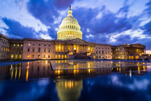 The US Capitol In Washington DC At Nightfall With Dramatic Clouds