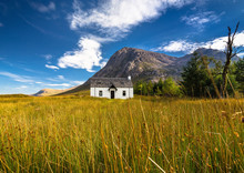 The Remote Lagangarbh Hut In Front Of Buachaille Etive Mor In Glen Coe On A Beautiful Summer Afternoon, Scotland