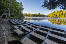 Aluminum Rowboats For Rent At Tahquamenon Falls. Group Of Rowboats Line The Dock At Tahquamenon Falls For Tourists To Row Out To View The Lower Falls At The Michigan State Park.