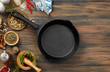 Cooking ingredients and pan on wood