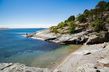 Serene Scandinavian Summer Landscape On South Coast Of Norway. Sunny Rocky Beach With Turquoise Quiet Water.