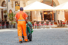 Man Working As Cleaner And Janitor At The City Street, Job Concept
