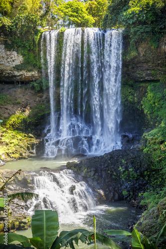 Poster Watervallen Waterfall in forest in Dam Bri, Vietnam