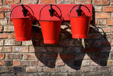 Three Red Fire Buckets, Levish...
