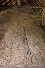 Hay Stack And Hay Rake In Barn