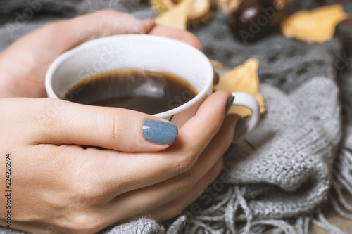 Fototapeta  Cup of coffee and gray knitted background. Autumn concept.