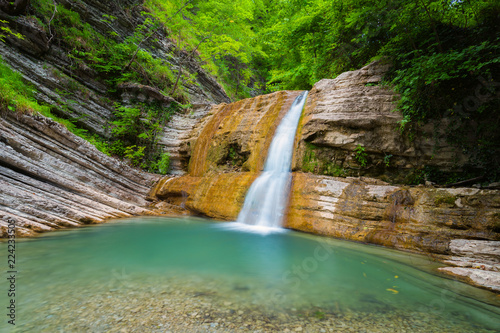 Poster Watervallen Waterfall from small river in mountain of Caucasus. Summer landscape with waterfall and water stream in forest of Caucasus mountain.