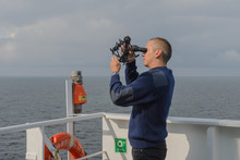 Seaman With Sextant On Navigational Bridge