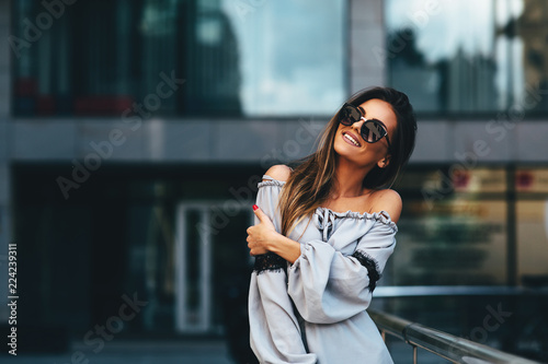 Portrait of a beautiful young woman in the city Canvas Print