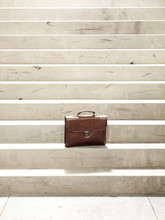 Leather Briefcase On Stairway