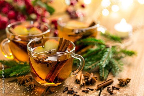 Tuinposter Bier / Cider Mulled cider with cinnamon, cloves and anise. Traditional Christmas drink