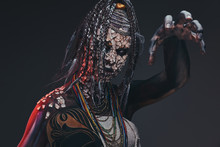 Scary African Shaman With A Petrified Cracked Skin And Dreadlocks. Make-up Concept.