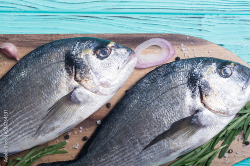 Acrylic Prints Fish Raw dorado fish and ingridient for cooking