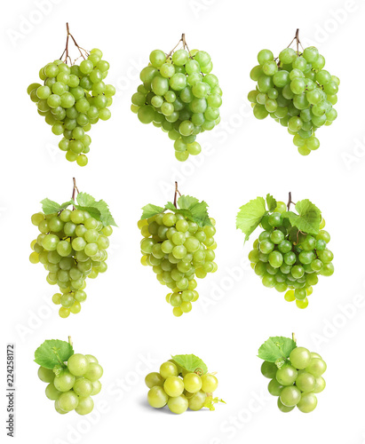 Set with juicy ripe grapes on white background