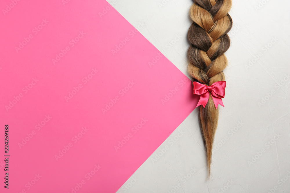 Fototapety, obrazy: Braid and space for text on color background, top view. Healthy hair