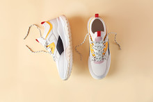 Pair Of Stylish Sneakers On Co...