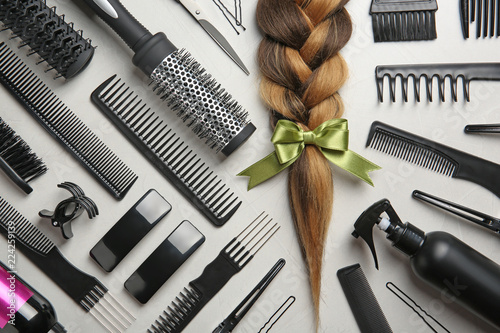 Carta da parati Flat lay composition with braid and hairdresser's tools on gray background