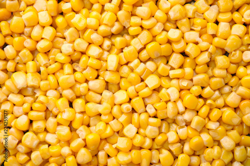 Ripe corn kernels as background, top view