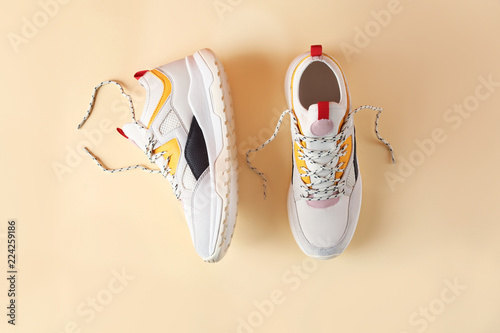 Pair of stylish sneakers on color background, top view Fototapeta