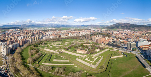 Leinwand Poster Aerial view of Pamplona citadel with blue clodu sky background on a spring morni