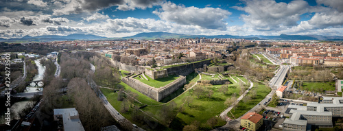 Fotografie, Tablou Aerial panorama view of fortified medieval Pamplona in Spain with dramatic cloud