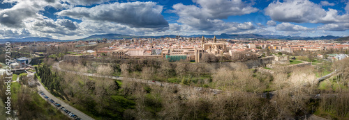 Aerial panorama view of fortified medieval Pamplona in Spain with dramatic cloud Fotobehang