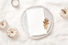 Bright Elegant Menu Or Invitation Card Mockup With Festive Autumn / Fall Themed Table Setting With White Pumpkins, Candle And Natural Leaf, Ideal For  Thanksgiving Or Seasonal Weddings - Flat Lay