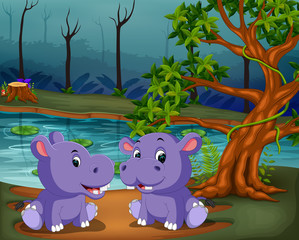 the river view with two big purple hipopotamus playing together