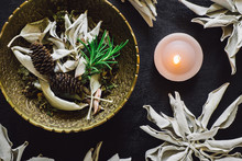 Bowl Of Mixed Herbs And White Sage With Candle