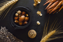 Black Cauldron With Acorns And Dried Wheat, Seeds And Flowers