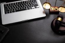 Justice And Law Concept.Lawyer Workplace With Laptop And Documents With Black Dark. Top View