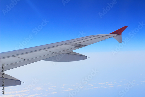 Ailerons and flaps tucked flat in airplane wing at cruise speed Wallpaper Mural