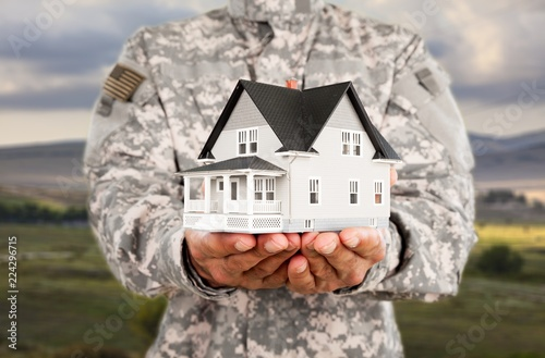 Military man Holding House Model, Real Estate - Buy this stock photo