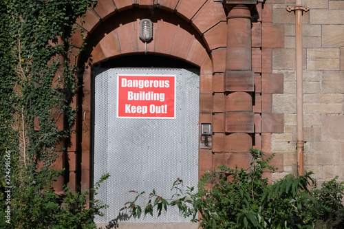 Fotografie, Obraz  Dangerous building unstable keep out sign on entrance door